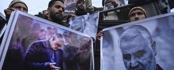 FILE: Protesters shout slogans against the United States and Israel as they hold posters with the image of top Iranian commander Qasem Soleimani, who was killed in a US airstrike in Iraq, and Iranian President Hassan Rouhani during a demonstration in the Kashmiri town of Magam on 3 January 2020. Picture: AFP.