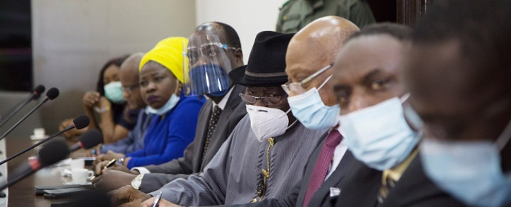 Former Nigerian president Goodluck Jonathan (C), wearing a face mask, prepares for a meeting between Malian military leaders and an Ecowas delegation headed by former Nigerian president on 22 August 2020, in an aim to restore order after the military coup in Bamako. Picture: AFP