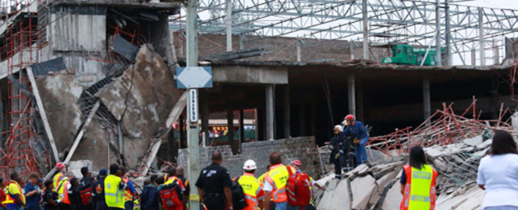 Rescuers search for construction workers still unaccounted for under the rubble at the Tongaat Mall, after a floor collapsed in Tongaat, 45 kilometres south of Durban on 19 November, 2013. Picture:AFP