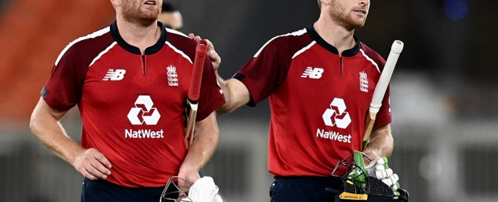 England's Jonny Bairstow (L) and teammate Jos Buttler walk back to the pavilion after their win in the third Twenty20 international cricket match between India and England at the Narendra Modi Stadium in Motera on March 16, 2021. Picture: Jewel Samad / AFP.