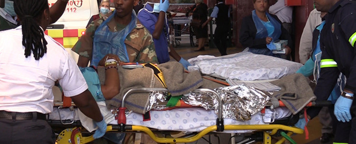 FILE: A victim of the Nigerian church collapse is stretchered into the Steve Biko Academic Hospital, Monday 22 September 2014, Picture: Vumani Mkhize/EWN.