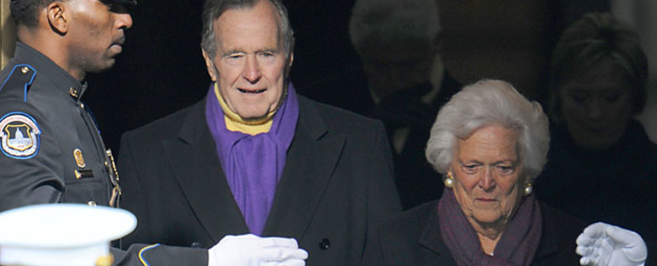 FILE: Former US president George HW Bush and his wife Barbara arrive for the inauguration of Barack Obama as the 44th US president at the Capital in Washington on January 20, 2009. Picture: AFP.