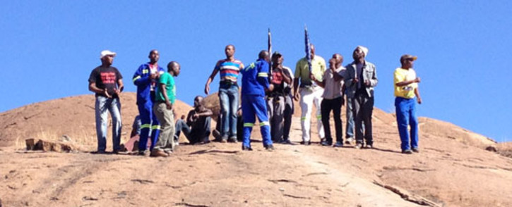 Miners gather on the koppie in Marikana ahead of the anniversary of the shooting in which 34 miners were killed. Picture: Christa van der Walt/EWN.