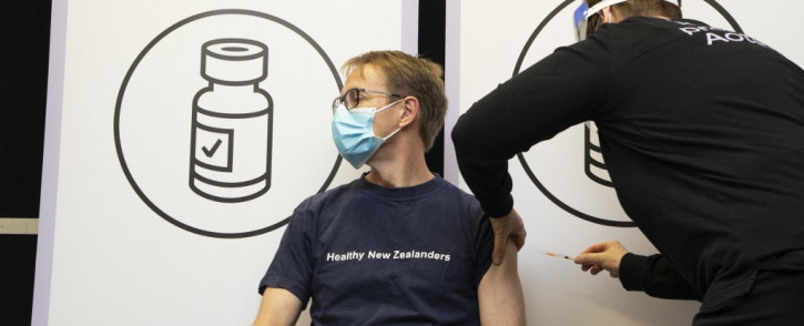 New Zealand's Director-General of Health Ashley Bloomfield receives his first dose of a COVID-19 vaccine at the Pipitea Marae vaccination centre in Wellington on 23 August 2021. Picture: Ross Giblin/AFP