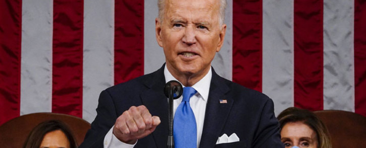 US President Joe Biden addresses a joint session of Congress as Vice President Kamala Harris (L) and Speaker of the House US Rep. Nancy Pelosi (D-CA) (R) look on in the House chamber of the US Capitol on 28 April 2021 in Washington, DC. Picture: AFP