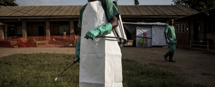 FILE: A hygienist is seen inside an Ebola Treatment Centre run by The Alliance for International Medical Action (ALIMA) on 12 August 2018, in Beni. Picture: AFP