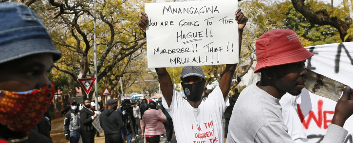 Protestors hold up placards against the government of Zimbabwe's alleged state corruption, media freedom and the deteriorating economy on 7 August 2020. Picture: AFP