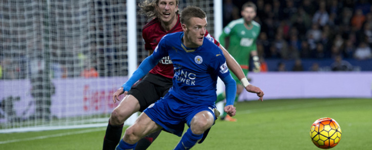 Leicester Citys English striker Jamie Vardy (R) is closely marked by West Bromwich Albions Swedish defender Jonas Olsson (L) during the English Premier League football match between Leicester City and West Bromwich Albion at the King Power Stadium in Leicester, central England on 1 March, 2016. Picture: AFP.