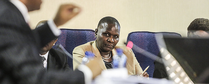 Suspended National Police Commissioner Riah Phiyega listens to representation by Advocate Dali Mpofu during closing arguments at the inquiry into her fitness to hold office in Centurion on 1 June 2016. Picture: Reinart Toerien/EWN.