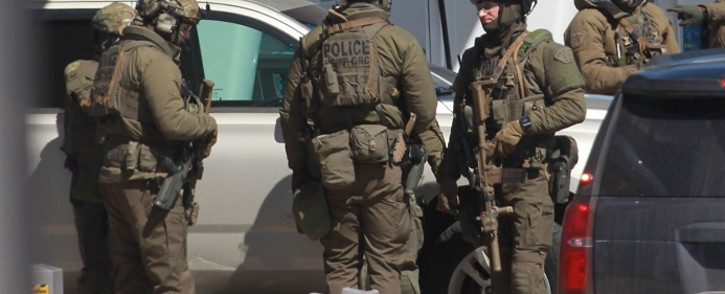 FILE: Members of the Royal Canadian Mounted Police (RCMP) tactical unit confer after the suspect in a deadly shooting rampage was neutralised at the Big Stop near Elmsdale, Nova Scotia, Canada, on 19 April 2020. Picture: AFP.