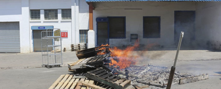 Barricades are seen in a road during a protest in Mbabane, on 21 October 2021. At least 80 people were injured in eSwatini on 20 October 2021, a union leader said, as security forces cracked down on escalating pro-democracy protests in Africa's last absolute monarchy. Picture: AFP