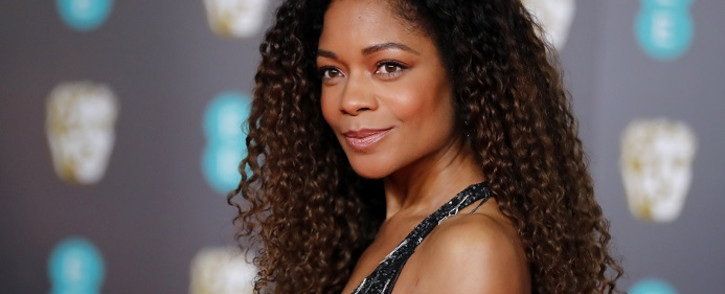 British actress Naomie Harris poses on the red carpet upon arrival at the BAFTA British Academy Film Awards at the Royal Albert Hall in London on 2 February 2020. Picture: AFP.
