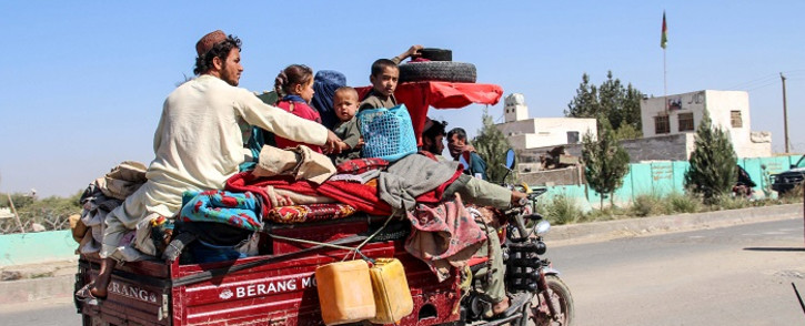 Internally displaced people with their belongings flee from Nadali district to Lashkar Gah during the ongoing clashes between Taliban fighters and Afghan security forces, in Helmand province on 14 October 2020. Picture: AFP