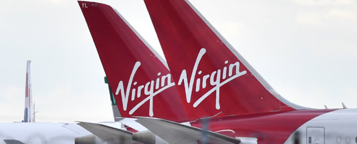 Virgin Atlantic passenger aircraft are pictured on the apron at Heathrow Airport, west of London on 2 April 2020. Picture: AFP