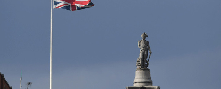 A Union flag flaps in the wind on a building near to Nelson's Column in Trafalgar Square, in central London on 28 March 2017. Picture: AFP.