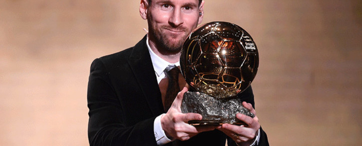 FILE: Barcelona's Argentinian forward Lionel Messi reacts after winning the Ballon d'Or France Football 2019 trophy at the Chatelet Theatre in Paris on December 2, 2019. Picture: AFP.