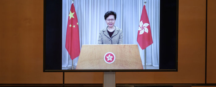 Hong Kong's chief executive Carrie Lam is seen on a giant screen remotely addressing the opening of the UN Human Rights Council's 44th session on 30 June 2020 in Geneva. Picture: AFP