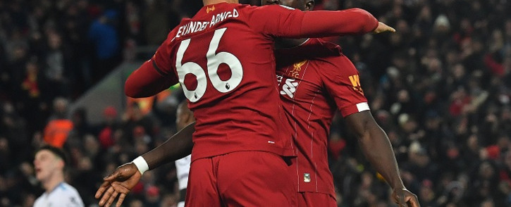 Liverpool's Senegalese striker Sadio Mane (R) celebrates with Liverpool's English defender Trent Alexander-Arnold after scoring his team's third goal during the English Premier League football match between Liverpool and West Ham United at Anfield in Liverpool, north west England on 24 February 2020. Picture: AFP
