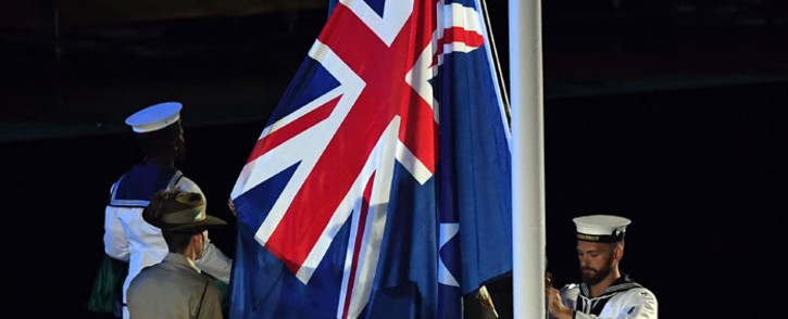 FILE: The Australian national flag is raised during the opening ceremony of the 2018 Gold Coast Commonwealth Games at the Carrara Stadium on the Gold Coast on April 4, 2018. Picture: AFP