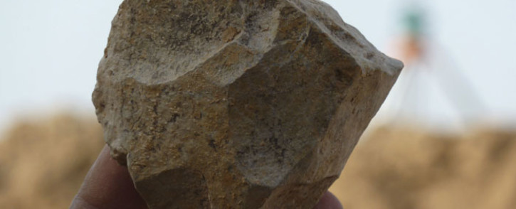 This handout image obtained 29 November 2018 shows an Oldowan core (stone tool) freshly excavated at Ain Boucherit from which sharp-edged cutting flakes were removed. Picture: AFP