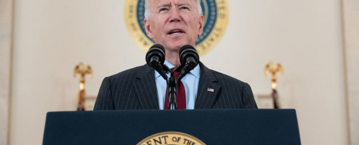 US President Joe Biden speaks about lives lost to COVID-19 after death toll passed 500,000, in the Cross Hall of the White House in Washington, DC, 22 February 2021. Picture: AFP