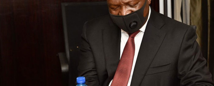 FILE: Deputy President David Mabuza follows sanitisation protocols as he assesses the Free State's response to the coronavirus outbreak. Picture: @PresidencyZA/Twitter