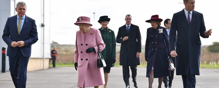 Britain's Queen Elizabeth II (C) and Britain's Prince William, Duke of Cambridge (R) arrive with Dstl Chief Executive Gary Aitkenhead (L) at the Energetics Analysis Centre as they visit the Defence Science and Technology Laboratory (Dstl) at Porton Down science park near Salisbury, southern England, on October 15, 2020. Picture: AFP