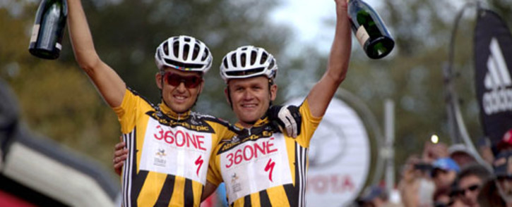 """Christoph Sauser and Burry Stander pictured here celebrating the overall win during the final stage of the 2011 Absa Cape Epic Mountain Bike stage race held from Oak Valley to Lourensford, Sunday, 3 April 2011. South African mountain bike ace Burry Stander died in a crash on Thursday, 3 January 2012.""""He was returning from a training ride in Shelly Beach, on the KwaZulu-Natal (KZN) south coast, and was hit by a vehicle,"""" said Cycling SA spokesperson Mylene Loumeau. Stander, 25, was fifth in the men's cross country race at the 2012 London Olympics. Picture: Karin Schermbrucker/Cape Epic/SPORTZPICS"""