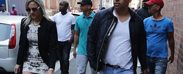 FILE: Ralph Stanfield (wearing black jacket and sunglasses)  appears in the Cape Town Magistrates Court with five other co-accused on 4 September, 2014. Picture: Thomas Holder/EWN