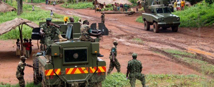 Soldiers of the Uganda People's Defence Force (UPDF) patrol in the northerneastern part of the Central African Republic to secure the area from rebel groups' possible attacks, on June 25, 2014. Picture: AFP.