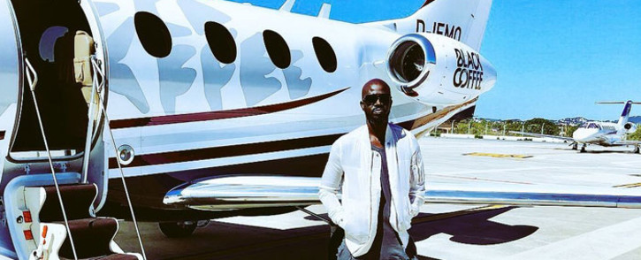 FILE: Black Coffee poses next to a personal jet. Picture: @RealBlackCoffee/Twitter