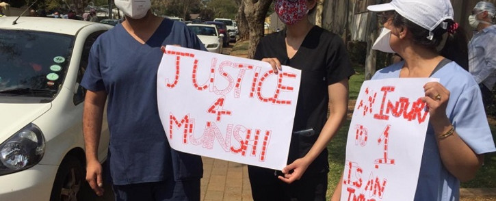 Healthcare workers gathered outside the home of Dr Abdulhay Munshi in Houghton to express their condolences to the family of the slain doctor and stand in solidarity with healthcare practitioners.Picture: Veronica Mokhoali/EWN