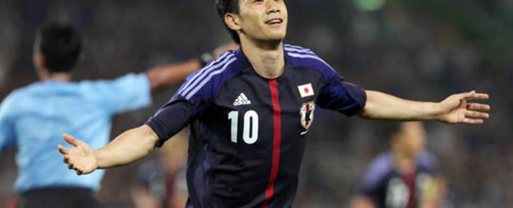 FILE: Japan's forward Shinji Kagawa celebrates his goal against Azerbaijan during an international friendly football match at Fukuroi in Shizuoka prefecture, central Japan, on May 23, 2012. Picture: AFP