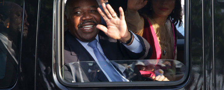 FILE: Gabonese President Ali Bongo Ondimba waves from his car upon his arrival in Libreville on 23 March 2019. Picture: AFP