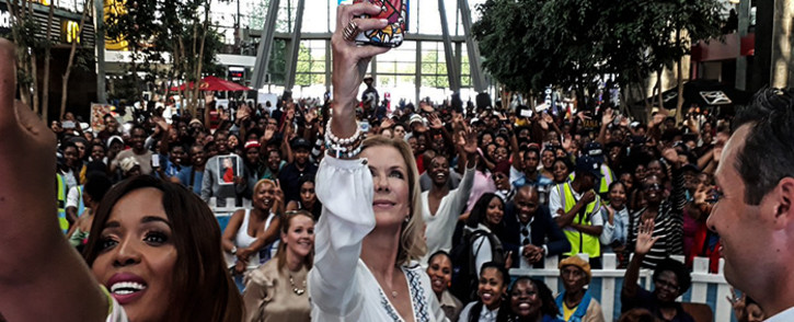 Katherine Lang who plays Brooke Logan in 'The Bold and The Beautiful' snaps a selfie with fans at Maponya Mall. Picture: Lungelo Matangira/EWN