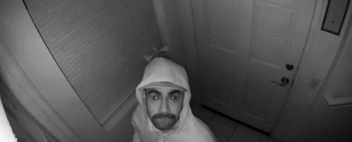 Man watches thief break into his house from across the country on Christmas Eve.