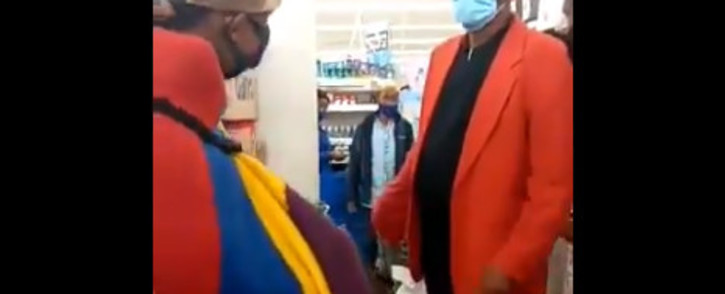 Screenshot of video where activist Thando Mhlangu can be seen in his traditional regalia inside a Clicks store at Boulders Shopping Centre in Midrand – while centre manager Jose Maponyane asks him to leave. Picture: Screengrab