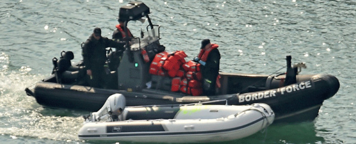 A dinghy and life-jackets, believed to have been taken from migrants picked up from boats in the Channel by UK Border Force officers, arrive in the harbour, in the port of Dover, on the south-east coast of England on 9 August 2020. Picture: AFP