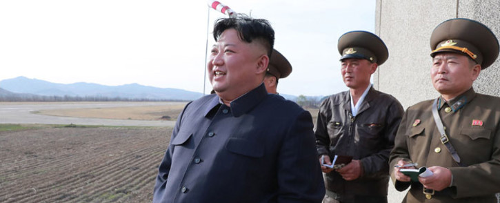 This picture released from North Korea's official Korean Central News Agency (KCNA) on 17 April 2019 shows North Korean leader Kim Jong-Un observing the flight drill of the combat pilots of Unit 1017 of the Air and Anti-aircraft Force of the Korean People's Army at an undisclosed place. Picture: AFP