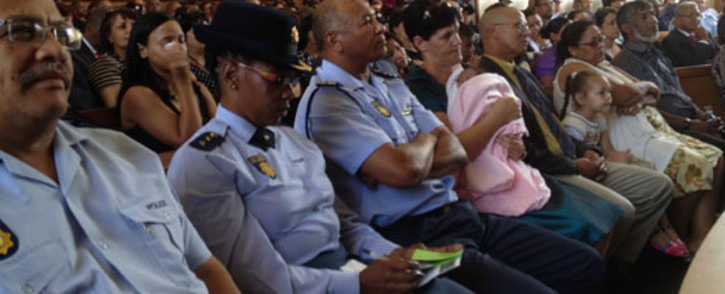 Relatives and colleagues attend a memorial service of two officers who were killed on Christmas Day. Picture: Regan Thaw/EWN
