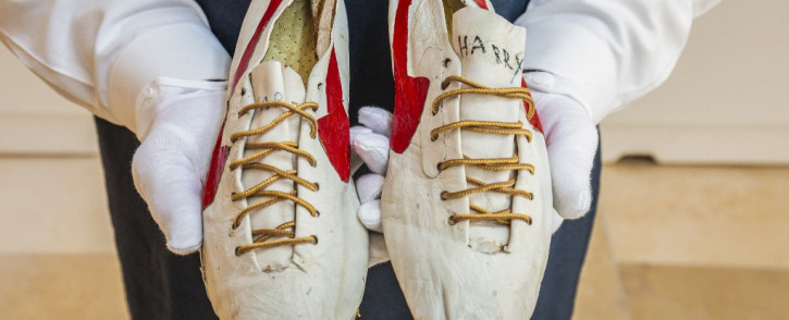 This handout photo taken and released by Sotheby's auctioneers on 7 July 2021 shows a pair of 'prototype logo' track spikes running shoes handmade by Nike co-founder Bill Bowerman for Canadian Track and Field sprinter and Olympian Harry Jerome in the 1960s and modified by Bowerman in the early 1970s, displayed prior to auction in New York. Picture: SOTHEBY'S / AFP