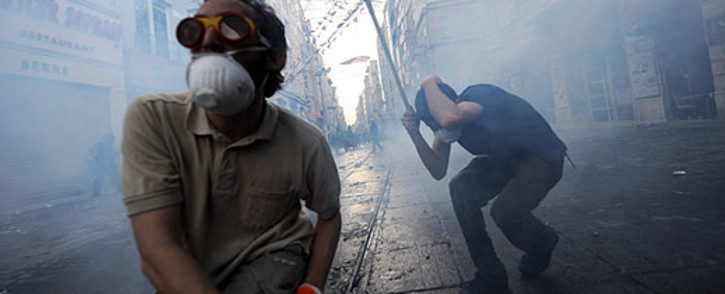 Protestors clash with Turkish riot policemen during a protest against the demolition of Taksim Gezi Park on 31 May 2013. Picture: AFP