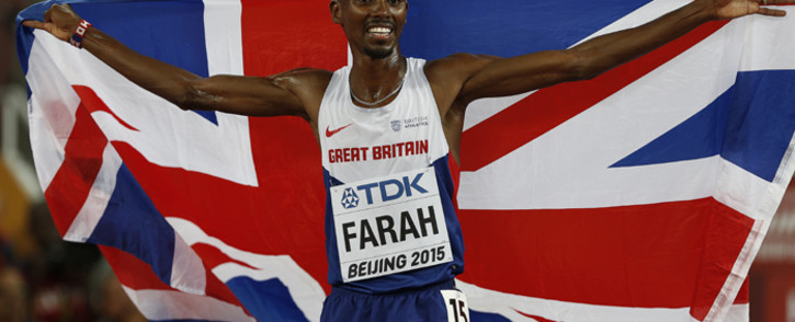 "FILE: Britain's Mo Farah celebrates winning the final of the men's 5000 metres athletics event at the 2015 IAAF World Championships at the ""Bird's Nest"" National Stadium in Beijing on 29 August, 2015. Picture: AFP."