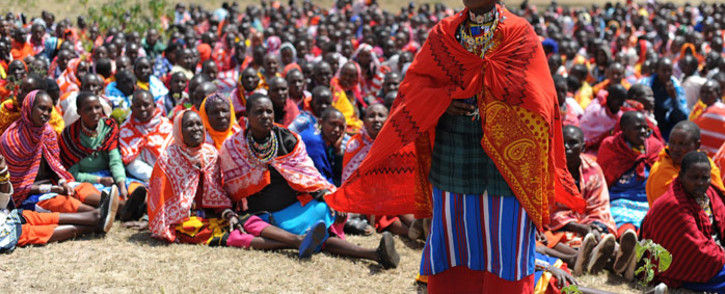 A woman speaks as Kenyan Maasai women gather for a meeting dedicated to the practice of female genital mutilation (FGM) in which several participants voiced opposition to a ban currently in place, on 12 June 2014. Picture: AFP