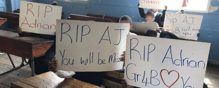 Pupils at the Holy Trinity Roman Catholic Primary School in Elsies River hold posters after their classmate Adrian Alexander was murdered on17 September 2019. Picture: Lauren Isaacs/EWN