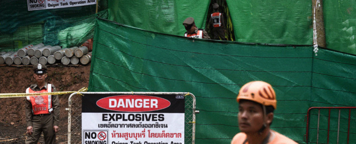 Thai police stand guard at the Tham Luang cave area as operations continue for the 12 boys and their coach trapped at the cave in Khun Nam Nang Non Forest Park in the Mae Sai district of Chiang Rai province on 8 July 2018. Picture: AFP