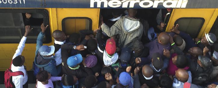 Commuters jostle to get onto a train at Phillipi Station on 20 April 2016. Picture: Xolani Koyana/EWN