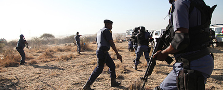 FILE: Police open fire at protesting workers at the Lonmin mine in Marikana, North West on 16 August, 2012. Picture: EWN.
