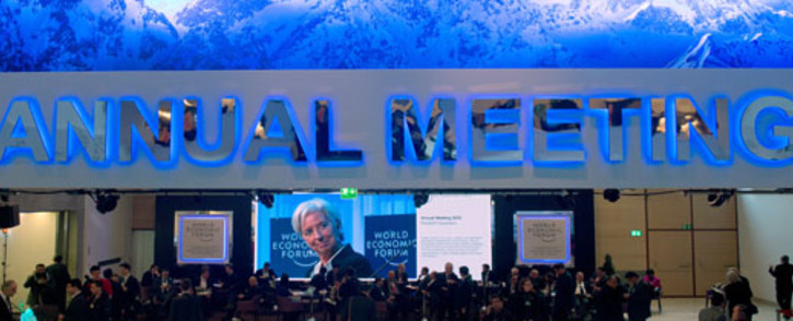 FILE: IMF Managing Director Christine Lagarde appears on screen during a session of the 2013 World Economic Forum annual meeting.  Picture: AFP.