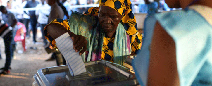 A women cast her ballot as part of the general elections, on 7 March 2018 at a polling station in Freetown in Sierra Leone. Picture: AFP